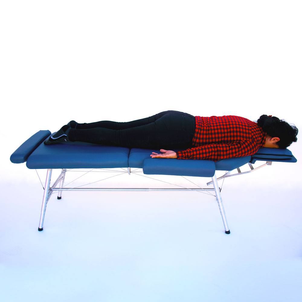 lightweight portable chiropractic table Chiroport elite extended neck in use by woman